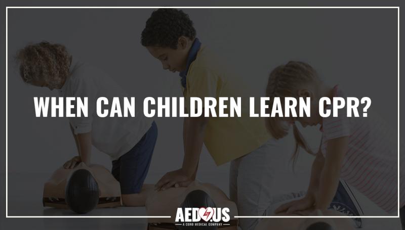 Children performing CPR on training manikins