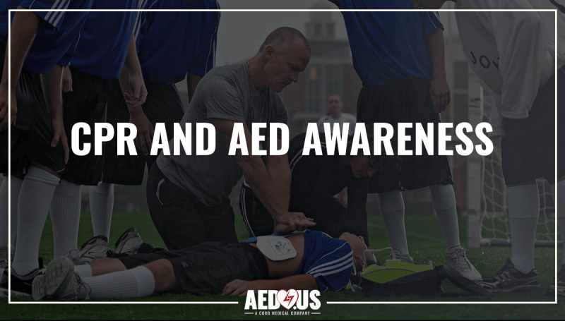Coach performing CPR on unresponsive young athlete on the soccer field with an AED Plus and electrodes.