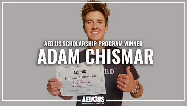 Man looking at the camera, doing a thumbs up, holding a certificate for the AED.US scholarship.